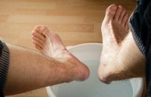 cooling feet in bucket of water